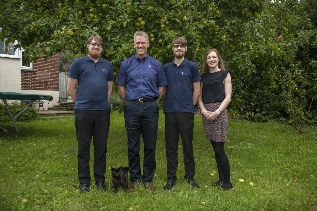 MazingTree Team in front of the apple tree